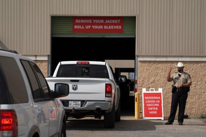 People are inoculated against coronavirus disease at a vaccination site in Robstown
