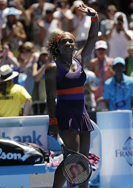 Serena Williams of the US waves to the crowd following her first round win over Romania's Edina Gallovits-Hall at the Australian Open tennis championship in Melbourne, Australia, Tuesday, Jan. 15, 2013. (AP Photo/Rob Griffith)