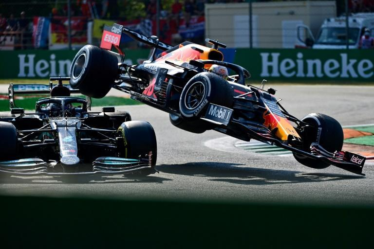 Mercedes' Lewis Hamilton (left) and Red Bull's Max Verstappen collided during the Italian Grand Prix in Monza (AFP/ANDREJ ISAKOVIC)