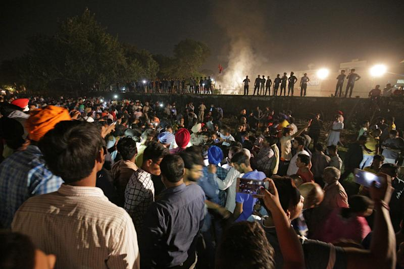 People and police gather on the site of a train accident in Amritsar, India, 19 October 2018. According to reports, at least 50 people were killed when a train ran over a crowd that was watching the burning of Ravana effigy during Dusshera celebrations. EPA/RAMINDER PAL SINGH