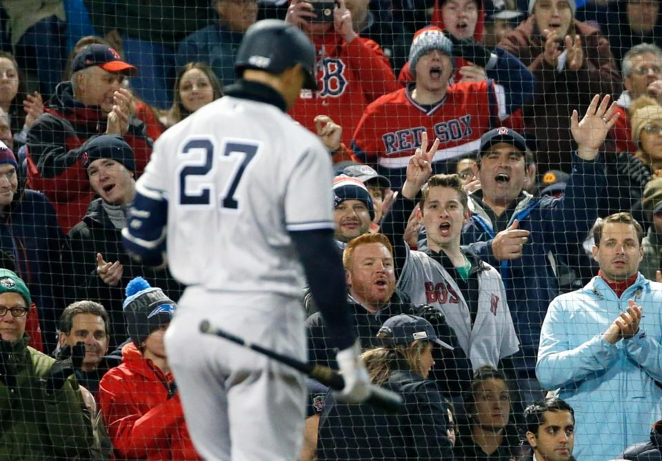 New York Yankees' Giancarlo Stanton walks to the dugout after striking out during the third inning of the team's baseball game against the Boston Red Sox in Boston, Tuesday, April 10, 2018. (AP Photo/Michael Dwyer)
