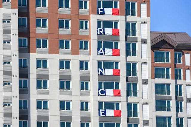 <p>The French national flags are displayed outside the team's dormitory in the Olympic Village in PyeongChang ahead of the PyeongChang 2018 Winter Olympic Games. (KIRILL KUDRYAVTSEV/AFP/Getty Images) </p>