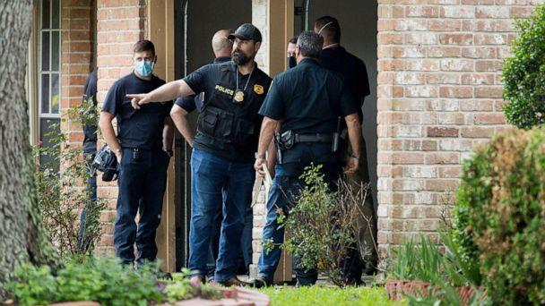 PHOTO: Police and first responders gather outside a home in Houston where officials say more than 90 people were found 'huddled together' in a possible case of human smuggling, April 30, 2021. (Godofredo A. Vasquez/Houston Chronicle)