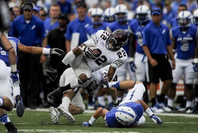 Colgate wide receiver Nat Bellamy (22) gets taken down against Air Force during an NCAA college football game Saturday, Aug., 31, 2013, in Air Force Academy, Colo. (AP Photo/The Colorado Springs Gazette, Michael Ciaglo)