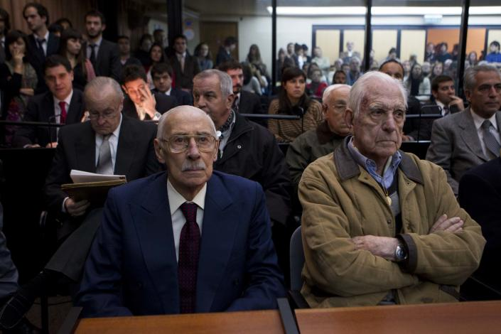 Former Argentina's dictators Jorge Rafael Videla, left, and Reynaldo Bignone wait to listen the verdict of Argentina's historic stolen babies trial in Buenos Aires, Argentina, Thursday, July 5, 2012. The two former dictators and a handful of other retired military and police officials are accused of systematically stealing babies from leftists who were kidnapped and killed when a military junta ran the country three decades ago. (AP Photo/Natacha Pisarenko)