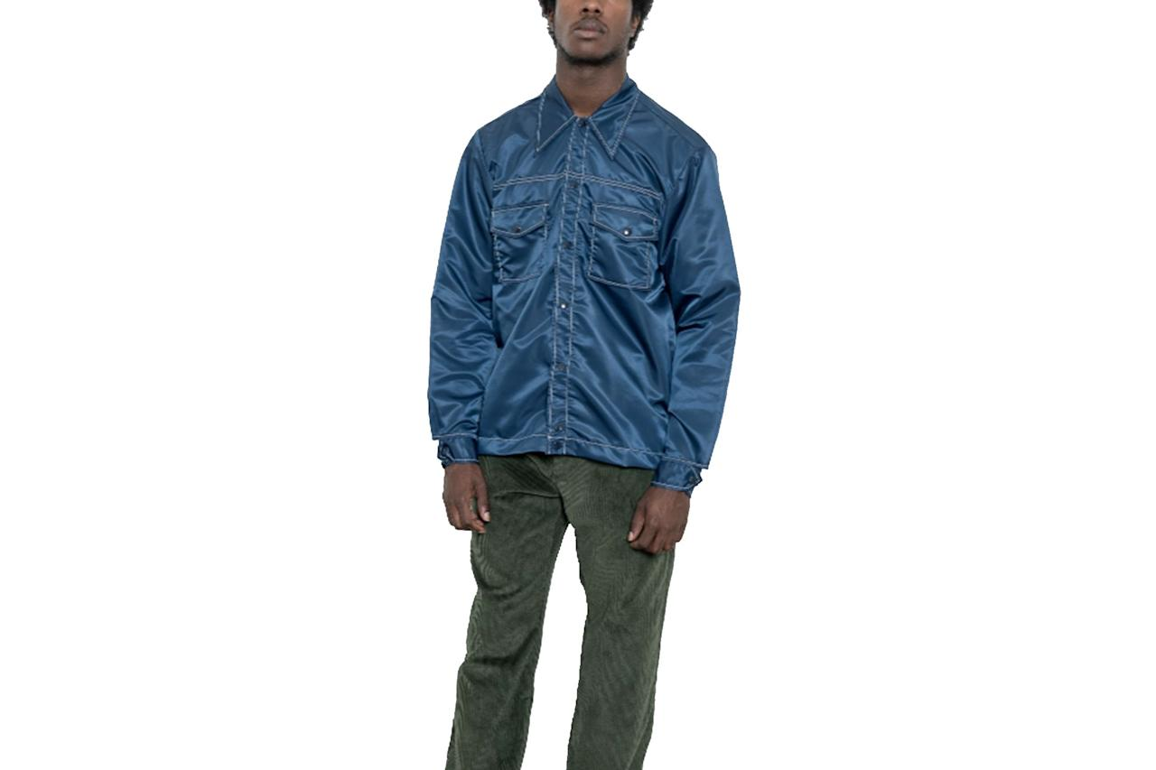 """This cowboy shirt/coach's jacket hybrid is the best mashup since that time someone dropped a Lil Wayne verse over *The Office* theme song. —Yang-Yi Goh $225, Paa. <a href=""""https://houseofpaa.com/collections/tops/products/rodeo-shirt-navy-nylon-twill"""">Get it now!</a>"""