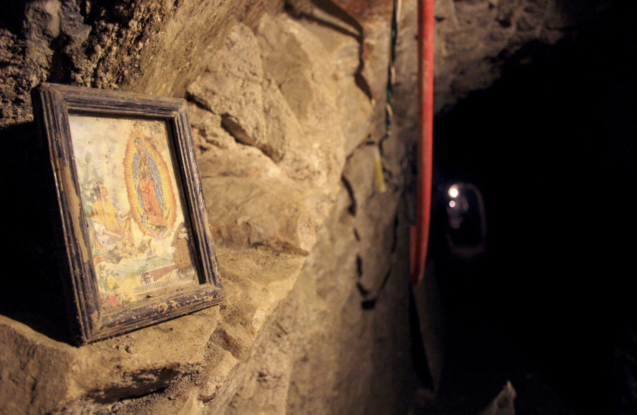 An image of the Virgin of Guadalupe is seen in a tunnel, nearly a mile (1.6 km) long running into California from Tecate near the Pacific coast, December 4, 2007, after it was discovered on Monday by law enforcement agencies. Gunmen killed the police chief of Tecate, a Mexican city bordering California, on Tuesday by shooting him some 50 times in an apparent revenge attack after police found the drug-smuggling tunnel under the border. REUTERS/Jorge Duenes (MEXICO)