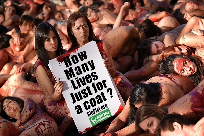 Animal rights activists protest against the fur industry in Barcelona on December 11, 2016