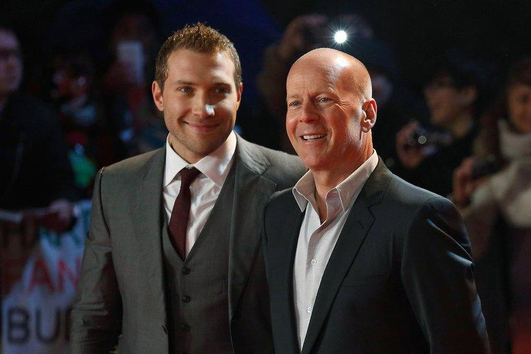 """Actors Jai Courtney (L) and Bruce Willis at the UK premiere of """"A Good Day To Die Hard"""" on February 7, 2013, in London"""