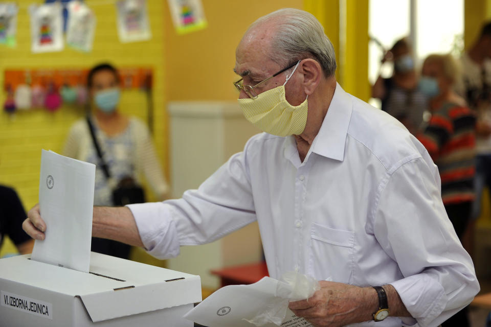 A voter casts his ballot at a polling station in Zagreb, Croatia, Sunday, July 5, 2020. Amid a spike of new coronavirus cases, voters in Croatia cast ballots on Sunday in what is expected be a close parliamentary race that could push the latest European Union member state further to the right. (AP Photo)