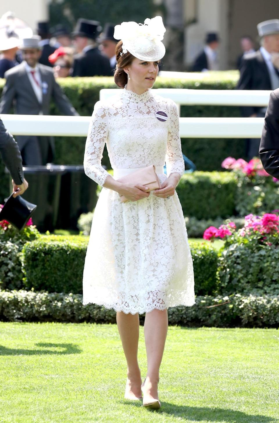 <p>Kate attended the first day of Royal Ascot 2017 wearing an eerily similar look to. her previous Ascot outfit. Instead of a white lacy Dolce & Gabbana dress, she chose a white lacy Alexander McQueen style with a matching hat and Gianvito Rossi heels. </p><p><i>[Photo: Getty]</i></p>