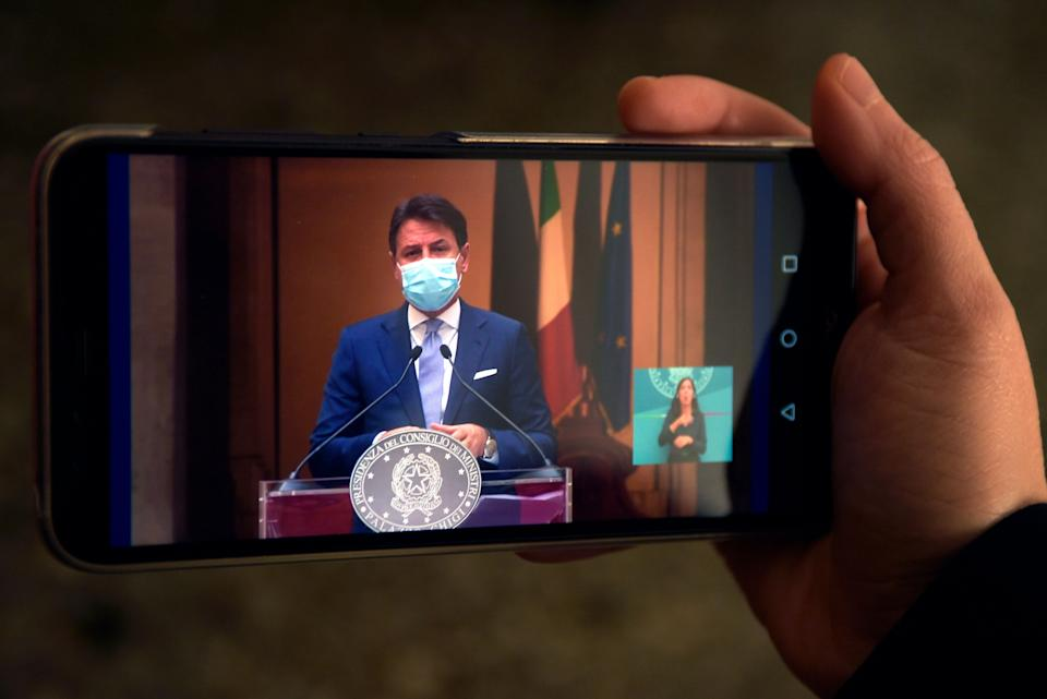 ROME, ITALY - 2020/10/25: In this photo illustration Italian Prime Minister Giuseppe Conte, wearing a face mask announcing the new anti Covid-19 measures live on Facebook during a press conference. Italian Prime Minister Giuseppe Conte holds a press conference to present the new measures to fight and contain the Covid-19 emergency. In Italy, according to the latest data there have been 20,000 cases of Covid-19 infection and over 150 of deaths on 24 October. (Photo Illustration by Vincenzo Nuzzolese/SOPA Images/LightRocket via Getty Images) (Photo: SOPA Images via Getty Images)
