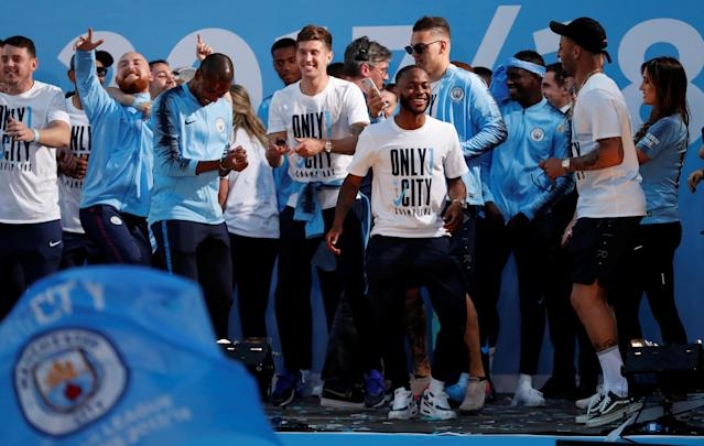 Soccer Football - Premier League - Manchester City Premier League Title Winners Parade - Manchester, Britain - May 14, 2018 Manchester City's Raheem Sterling celebrates with team mates during the parade Action Images via Reuters/Andrew Boyers