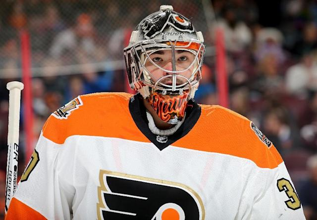 Michal Neuvirth of the Philadelphia Flyers, pictured in January 2017, was awaiting a faceoff at the far end of the ice when he fell backward in his crease and landed on his back (AFP Photo/ELSA)