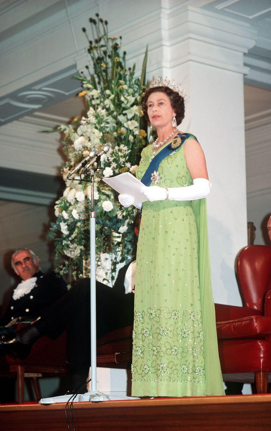 <p>During a royal tour in Australia, Queen Elizabeth dressed like Tiana in a green chiffon sheath gown with floral beading and elbow-length gloves, of course.</p>