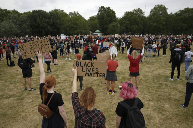 Protesters appear to follow social distancing rules as they stand apart during the Black Lives Matter protest in Hyde Park. (AP)