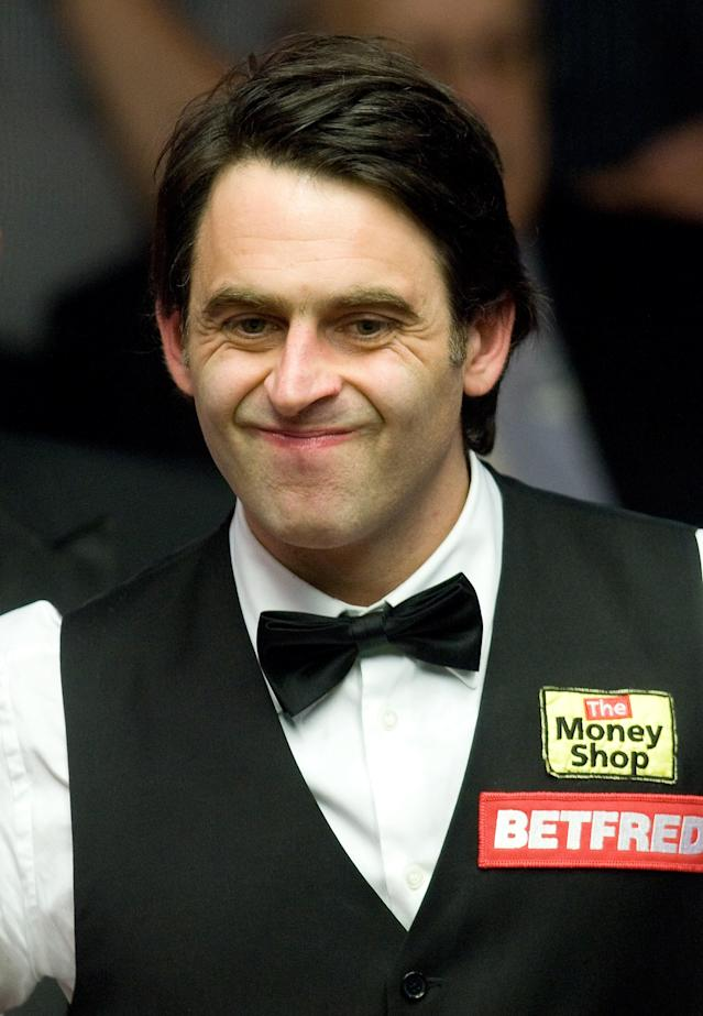 Ronnie O'Sullivan of Great Britain reacts during the first round match of the World Championship Snooker tournament against Peter Ebdon of Great Britain at the Crucible Theatre in Sheffield, north-west England on April 23, 2012. AFP PHOTO/ANDREW YATES. (Photo credit should read ANDREW YATES/AFP/Getty Images)