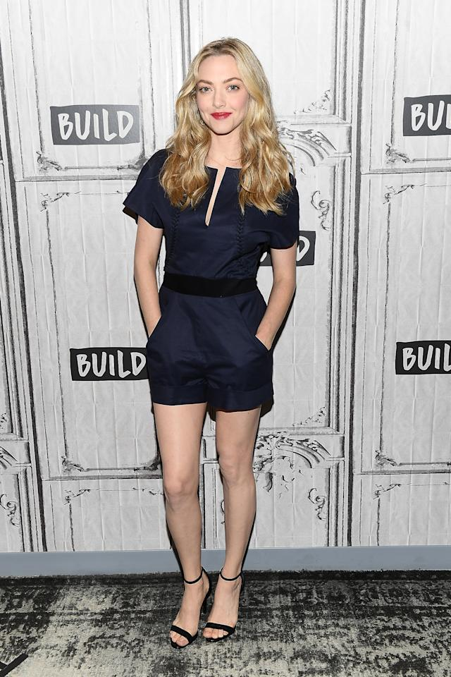 <p>On 19 July, Amanda Seyfried visited Build Studio in New York City wearing a navy-hued playsuit. <em>[Photo: Getty]</em> </p>
