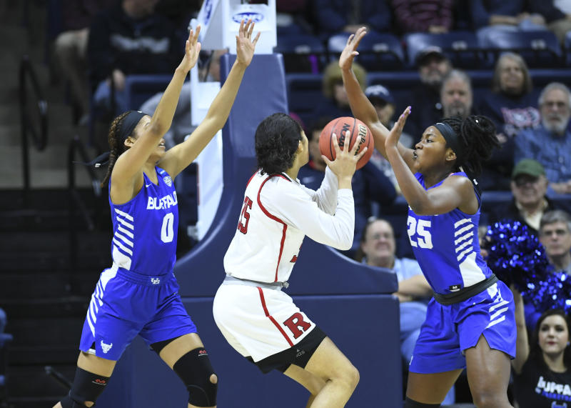 Rutgers' Stasha Carey (35) is guarded by Buffalo's Summer Hemphill (0) and Adebola Adeyeye (25) during a first round women's college basketball game in the NCAA Tournament, Friday, March 22, 2019, in Storrs, Conn. (AP Photo/Stephen Dunn)