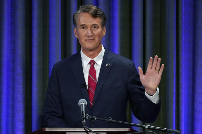 Republican gubernatorial candidate Glenn Youngkin, waves to supporters at the start of a debate at the Appalachian School of Law in Grundy, Va., Thursday, Sept. 16, 2021. (AP Photo/Steve Helber)