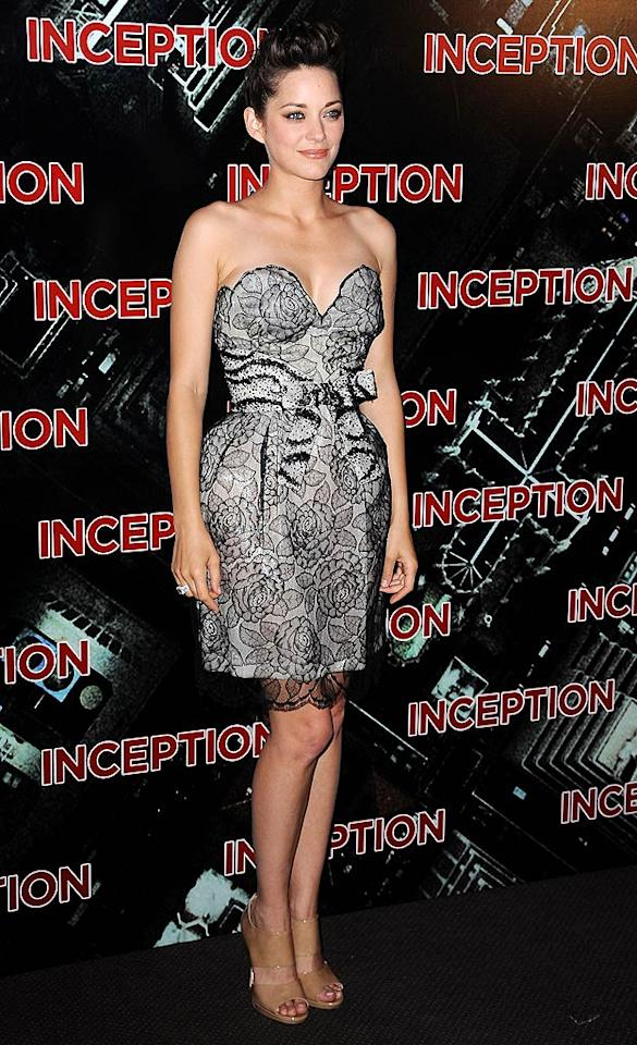 "Marion Cotillard, who happens to be the celebrity face of Dior, wore one of the fashion house's best pieces -- a lacy, bow-adorned dress -- to the Parisian premiere of ""Inception."" The Oscar winner paired the garment with $950 Jimmy Choo sandals and a chic updo. Pascal Le Segretain/<a href=""http://www.gettyimages.com/"" target=""new"">GettyImages.com</a> - July 10, 2010"