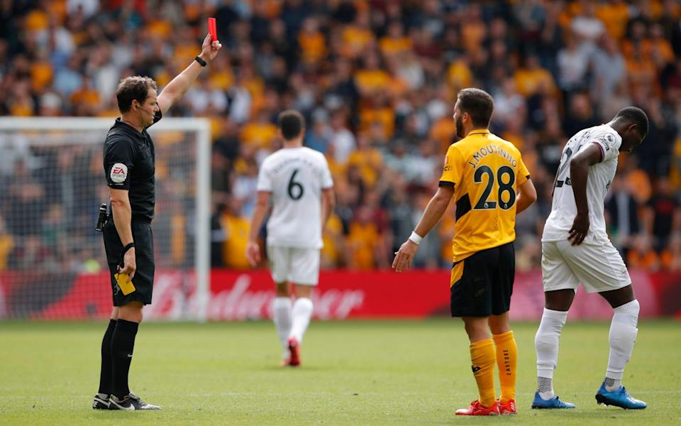 Shandon Baptiste is shown a red card by referee Darren England after receiving two yellow cards. - Reuters/Andrew Couldridge