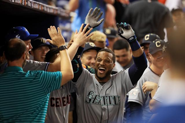 <p>Robinson Cano #22 of the Seattle Mariners and the American League celebrates with teammates after hitting a home run in the tenth inning against the National League during the 88th MLB All-Star Game at Marlins Park on July 11, 2017 in Miami, Florida. (Photo by Mike Ehrmann/Getty Images) </p>