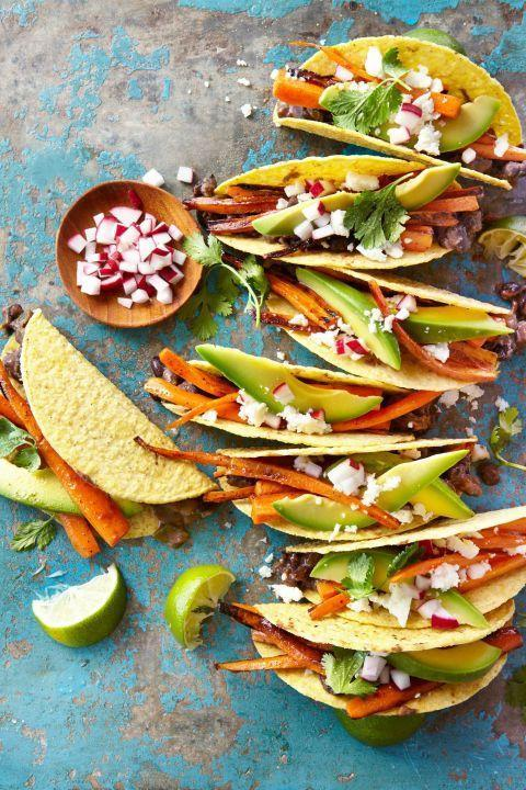 """<p>Spiced, roasted carrots form the backbone of this surprisingly robust taco.</p><p><strong><a href=""""https://www.countryliving.com/food-drinks/recipes/a39363/carrot-and-black-bean-crispy-tacos-recipe/"""" rel=""""nofollow noopener"""" target=""""_blank"""" data-ylk=""""slk:Get the recipe"""" class=""""link rapid-noclick-resp"""">Get the recipe</a>.</strong></p><p><strong><a class=""""link rapid-noclick-resp"""" href=""""https://www.amazon.com/dp/B00282JL7G?tag=syn-yahoo-20&ascsubtag=%5Bartid%7C10050.g.32934702%5Bsrc%7Cyahoo-us"""" rel=""""nofollow noopener"""" target=""""_blank"""" data-ylk=""""slk:SHOP SHEET PANS"""">SHOP SHEET PANS</a><br></strong></p>"""