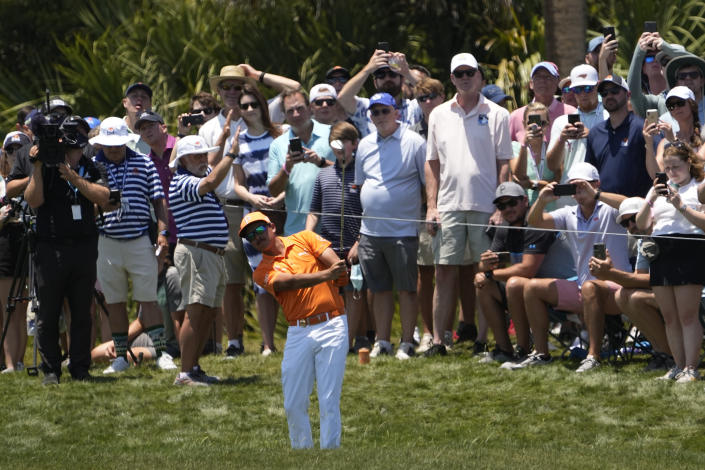 Rickie Fowler hits his second shot on the first hole during the final round at the PGA Championship golf tournament on the Ocean Course, Sunday, May 23, 2021, in Kiawah Island, S.C. (AP Photo/David J. Phillip)
