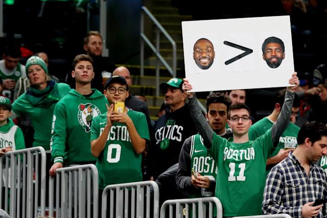 Celtics fans let Kyrie Irving hear their displeasure with his exit. (Maddie Meyer/Getty Images)