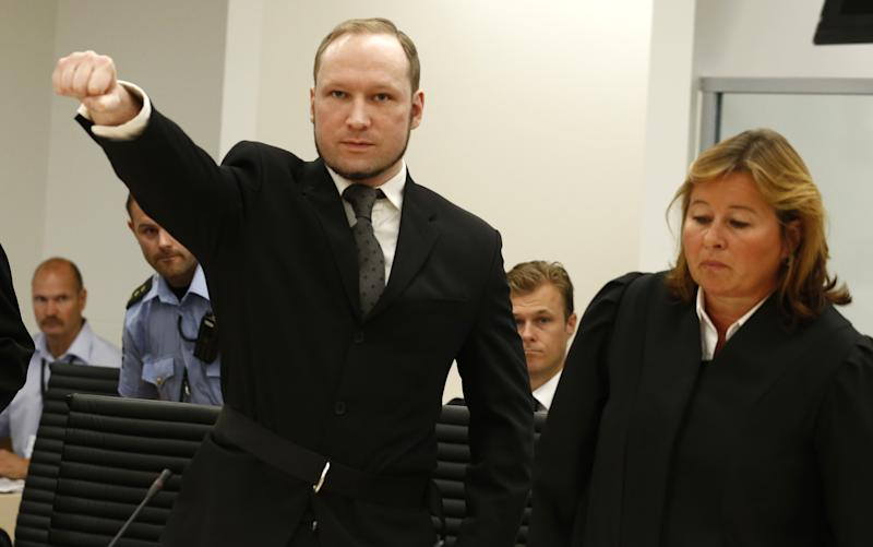 Mass murderer Anders Behring Breivik, makes a salute after  arrives at the court room in a courthouse in Oslo  Friday Aug. 24, 2012 .   Breivik, who admitted killing 77 people in Norway last year, declared sane and sentenced to prison for bomb and gun attacks.(AP Photo/Heiko Junge / NTB scanpix, Pool)