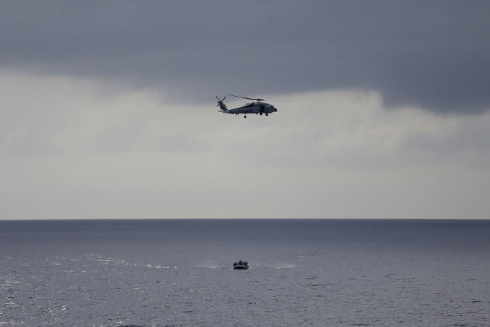 ADVANCED FOR USE SUNDAY FEB. 3 AND THEREAFTER In this Thursday, Oct. 11, 2012 photo a U.S. Navy helicopter and a RHIB boat participate in a drug interdiction training exercise onboard the USS Underwood while patrolling in international waters near Panama. In the most expensive initiative in Latin America since the Cold War, the U.S. has militarized the battle against drug traffickers, spending more than $20 billion in the past decade. U.S. Army troops, Air Force pilots and Navy ships outfitted with Coast Guard counternarcotics teams are routinely deployed to chase, track and capture drug smugglers. (AP Photo/Dario Lopez-Mills)