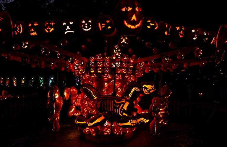 In Croton-on-Hudson visitors, many in costume, can still stand in awe of the pumpkins, which morph into everything from a huge Statue of Liberty to a planetarium and a carousel with skeleton horses, shown here
