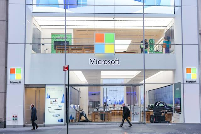 People walk past a Microsoft store entrance with the company's logo on top in midtown Manhattan at the 5th avenue in New York City, US, on 11 November 2019. Microsoft Corporation is world's largest software maker dominant in PC operating system Microsoft Windows, office applications, web browser and communication market. (Photo by Nicolas Economou/NurPhoto via Getty Images)
