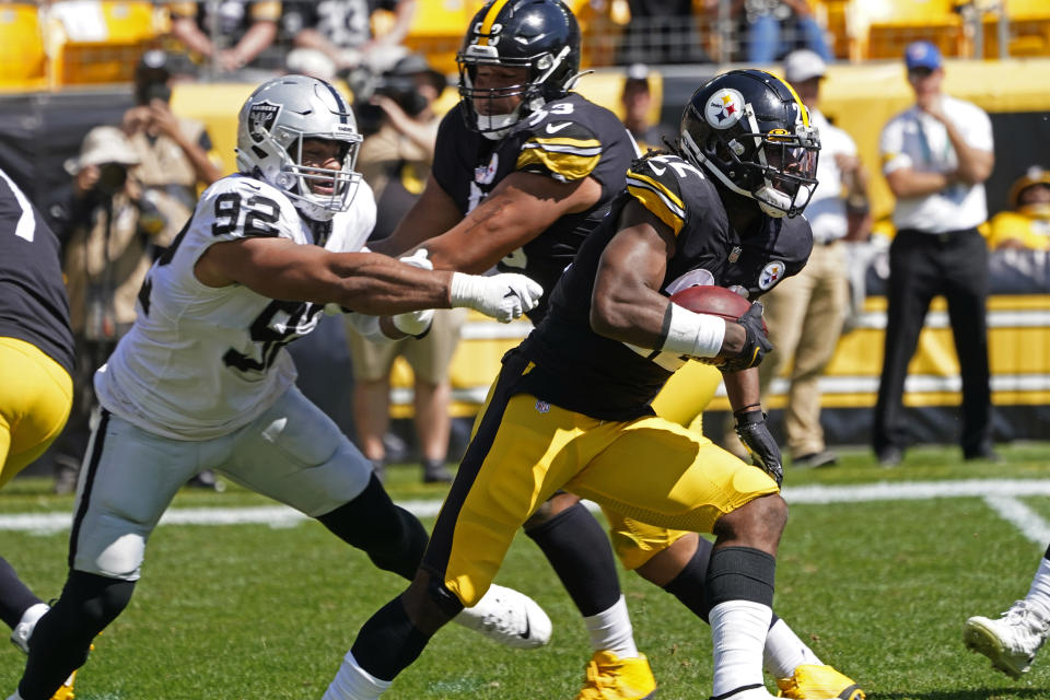 Pittsburgh Steelers running back Najee Harris (22) carries the ball past Las Vegas Raiders defensive end Solomon Thomas (92), with guard Kendrick Green (53) providing a block during the first half of an NFL football game in Pittsburgh, Sunday, Sept. 19, 2021. (AP Photo/Keith Srakocic)