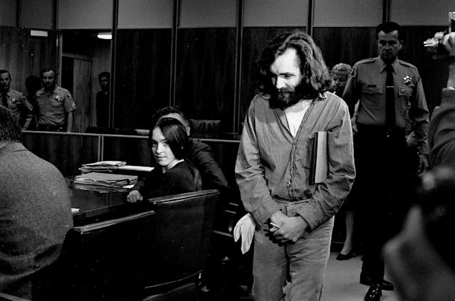 <p>Charles Manson walks into the courtroom in Santa Monica, Calif., on Oct. 13, 1970. Manson and Susan Atkins, seated, a member of his family of followers, were to plead on charges of murdering a Malibu musician, Gary Hinman. When his name was called, Manson stood, folded his arms, and turned his back on the judge. Atkins did the same. The court then entered pleas of not guilty. Both were on trial in Los Angeles for killings that included actress Sharon Tate. (Photo: AP) </p>