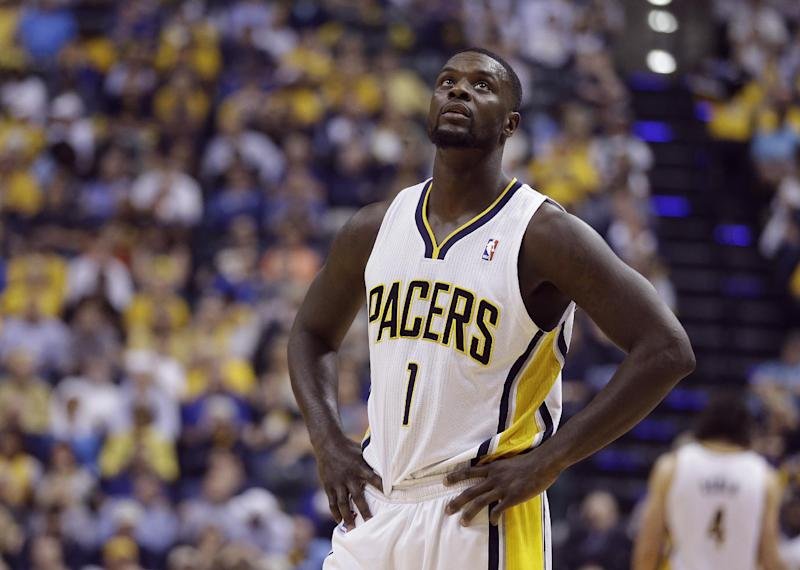 Indiana Pacers' Lance Stephenson (1) looks up at the scoreboard during the first half in Game 5 of an opening-round NBA basketball playoff series against the Atlanta Hawks Monday, April 28, 2014, in Indianapolis. (AP Photo/Darron Cummings)