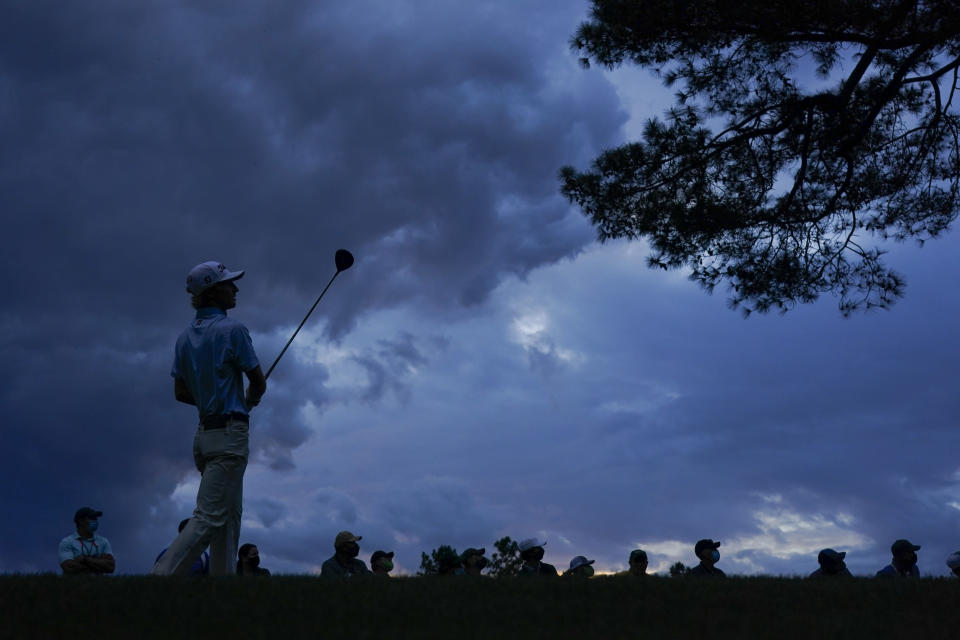 Will Zalatoris watches his tee shot on the 18th hole during the third round of the Masters golf tournament on Saturday, April 10, 2021, in Augusta, Ga. (AP Photo/Charlie Riedel)