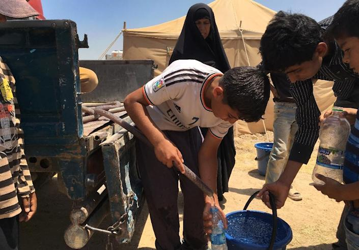 The Norwegian Refugee Council, which runs several camps in Amriyat al-Fallujah, south of Fallujah, is providing shelter and assistance to around 3,000 people who fled over the past week (AFP Photo/Ahmad Mousa)