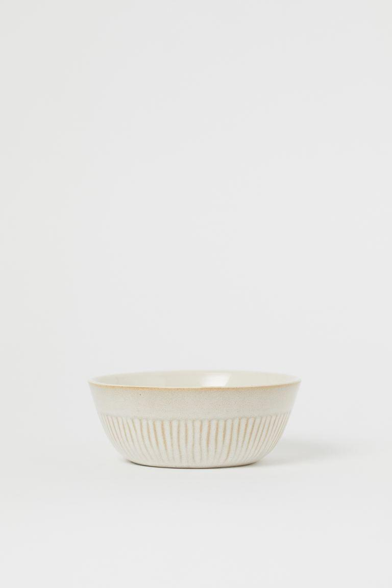 """<h2>Big Bowls<br></h2><br><h3><strong>H&M Ceramic Bowl</strong></h3><br>Bowls are the do-it-all dinnerware — you can safely eat everything from popcorn to oatmeal, pasta, homemade stews, and more from the comfort of your couch in them. This chic ceramic bowl (we suggest adding a set of four to your cart) is the perfect versatile addition to a new kitchen. <br><br><em>Shop <a href=""""https://www2.hm.com/en_us/productpage.0932162001.html"""" rel=""""nofollow noopener"""" target=""""_blank"""" data-ylk=""""slk:H&M"""" class=""""link rapid-noclick-resp""""><strong>H&M</strong></a></em><br><br><strong>H&M</strong> Ceramic Bowl, $, available at <a href=""""https://go.skimresources.com/?id=30283X879131&url=https%3A%2F%2Fwww2.hm.com%2Fen_us%2Fproductpage.0932162001.html"""" rel=""""nofollow noopener"""" target=""""_blank"""" data-ylk=""""slk:H&M"""" class=""""link rapid-noclick-resp"""">H&M</a>"""