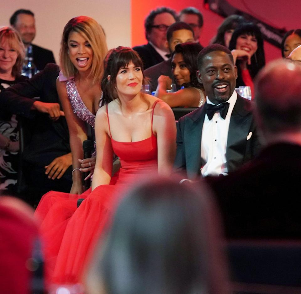 <p><em>This Is Us</em> actors Susan Kelechi Watson, Mandy Moore and Sterling K. Brown smiled at what host Cedric the Entertainer (not pictured) had to say during his joke-filled monologue.</p>