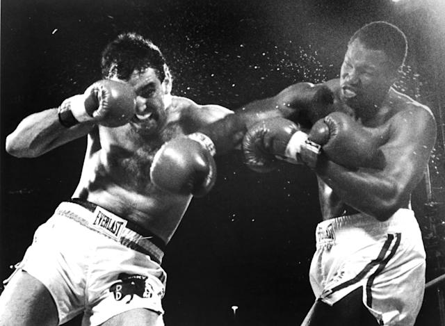 Larry Holmes (R) connects with a right hook against Gerry Cooney during the fight at Caesars Palace, on June 11, 1982 in Las Vegas, Nevada. (Getty Images)