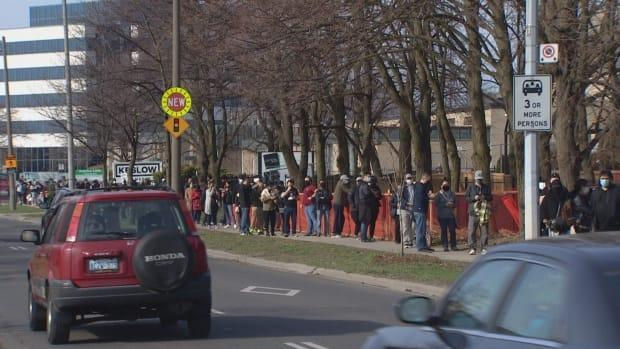 The lineup for the 1,000 shots available stretched down the block from a pop-up vaccination clinic at Masjid Darussalam Thorncliffe Mosque. It's one of 111 neighbourhoods in Toronto that have been disproportionately hard hit by the pandemic.  (Yanjun Li/CBC - image credit)