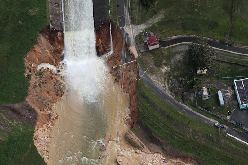 An aerial view shows the damage Saturday to the Guajataca dam in the aftermath of Hurricane Maria, in Quebradillas, Puerto Rico. (Alvin Baez / Reuters)