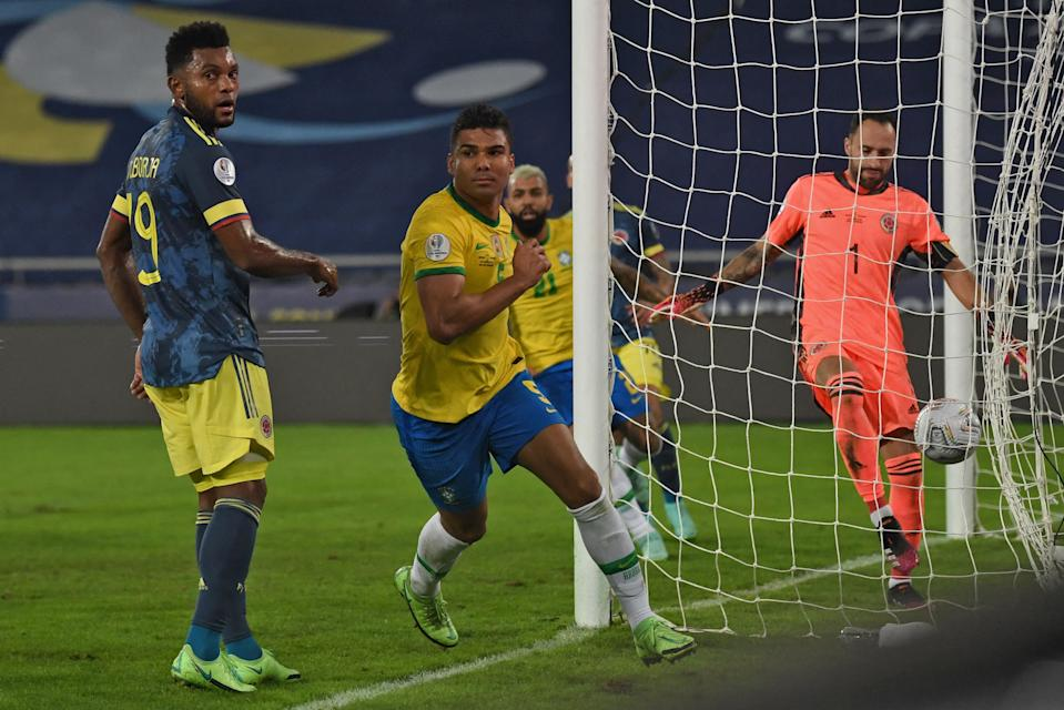 Brazil's Casemiro (C) celebrates after scoring against Colombia during the Conmebol Copa America 2021 football tournament group phase match, at the Nilton Santos Stadium in Rio de Janeiro, Brazil, on June 23, 2021. (Photo by CARL DE SOUZA / AFP) (Photo by CARL DE SOUZA/AFP via Getty Images)