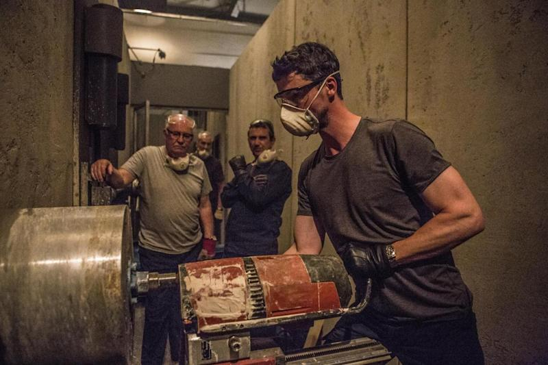 Breaking in: Matthew Goode drills through the underground vault