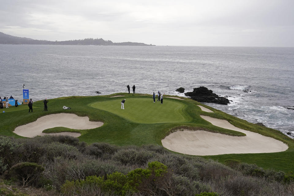 Daniel Berger putts on the seventh green of the Pebble Beach Golf Links during the final round of the AT&T Pebble Beach Pro-Am golf tournament Sunday, Feb. 14, 2021, in Pebble Beach, Calif. (AP Photo/Eric Risberg)
