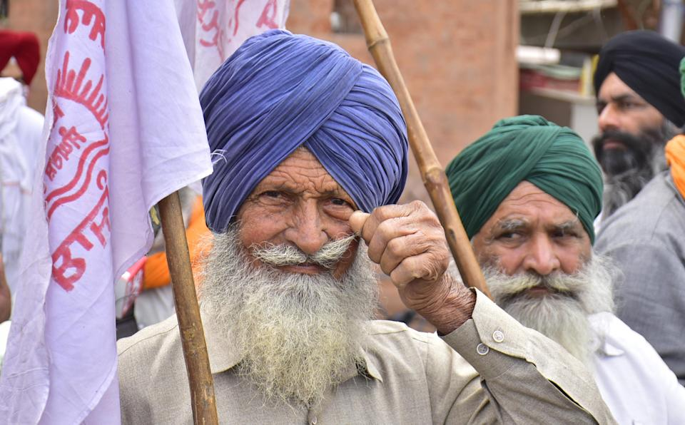 Farmers at Hall Bazaar as they appeal to keep shops closed on Bharat Bandh during their ongoing agitation against the new farm laws on March 25, 2021 in Amritsar, India. (Photo by Sameer Sehgal/Hindustan Times via Getty Images)