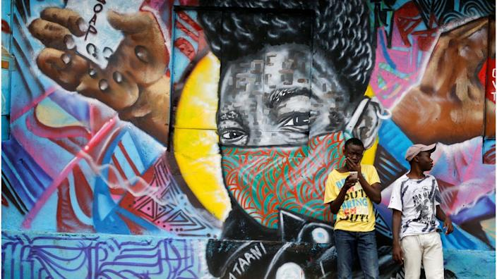 Kenyan artists have graffitied a wall in one area of the capital, Nairobi, to remind people of ways of staying safe