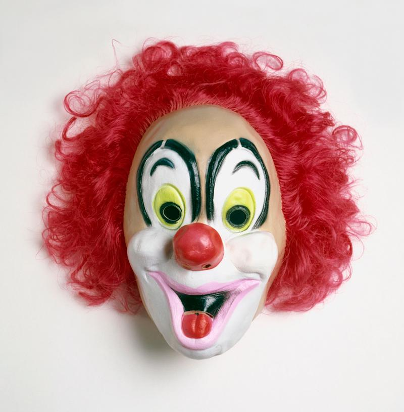 Thefather allegedly told police that he was only trying to discipline his daughter when he put on the clown mask, a similar one seen here, to scare her.
